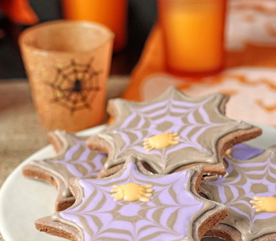 Chocolate sugar cookies with spider web royal icing