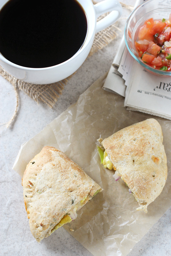 Breakfast Calzones | Simple calzones filled with scrambled eggs, pico de gallo, peppers and cheese! Perfect for a weekend breakfast or brunch!