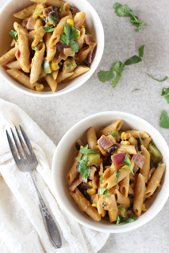Recipe for sweet potato and black bean pasta skillet. With a creamy sauce made of sweet potato and packed with plenty of veggies and spices!