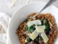 Recipe for nutty, chewy whole grain lemon garlic farro with mushrooms and spinach. Simple yet elegant.