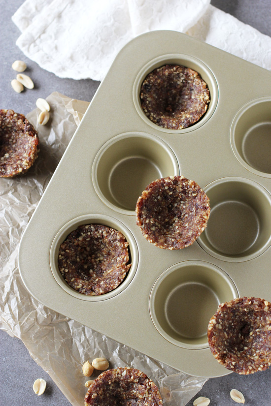 A simple, no bake recipe. With raw tart shells made with nuts and dates. And a coconut milk whipped cream filled with peanut butter!