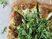 Recipe for arugula pesto pizza. With herbed ricotta, walnuts and lemon zest! Fresh, herby and cheesy!