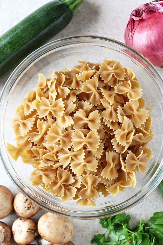 Recipe for mediterranean farfalle pasta salad. A light and flavorful dish that is delicious served hot or cold! Filled with veggies, herbs and a lemon mustard dressing.