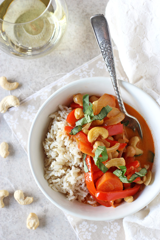 Recipe for vegetarian thai red curry with peppers and cashews. A creamy weeknight curry made with chickpeas, bell peppers and coconut milk!