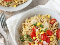 Recipe for light and summery brown butter tomato and corn angel hair pasta. With fresh corn, tomatoes, parmesan and lemon zest!