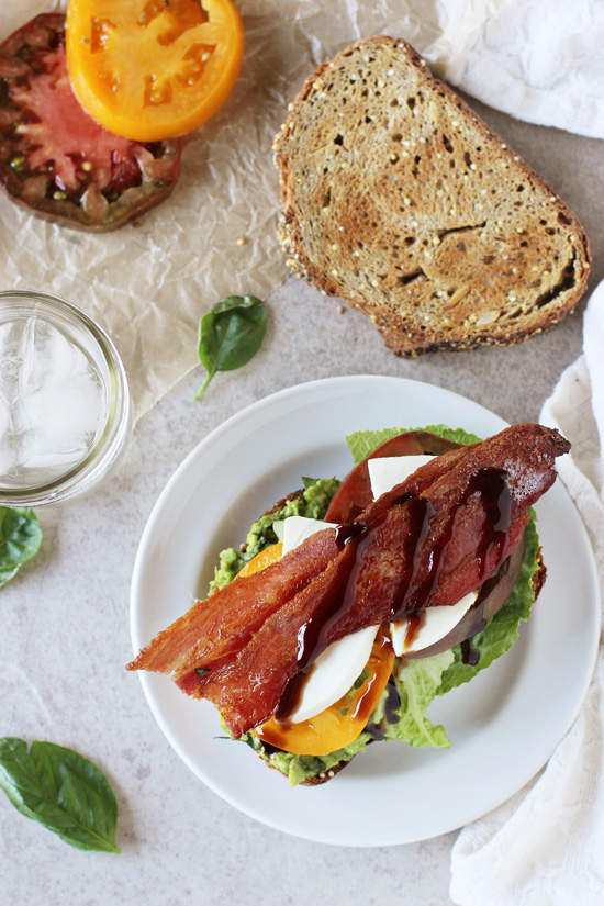 Recipe for quick and easy caprese avocado BLT. With mashed avocado, basil, juicy tomatoes, fresh mozzarella and crispy bacon! Finished with balsamic glaze!