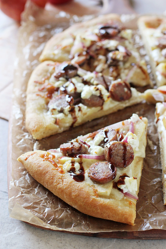 Recipe for sweet and savory apple bratwurst pizza. With sliced apples, sausage, red onion and goat cheese! An easy weeknight meal!