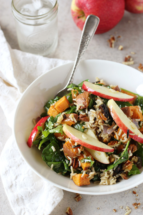 Recipe for harvest sweet potato and brown rice salad. With roasted sweet potatoes, brown rice, sliced apple, crunchy pecans and a simple maple dressing!