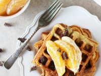 Recipe for orange and dark chocolate waffles. Made with white whole wheat flour and coconut oil! Filled with orange zest and chopped dark chocolate!