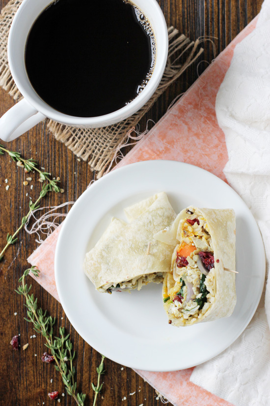 Recipe for freezer-friendly fall wild rice breakfast burritos. With eggs, plenty of veggies, cranberries, walnuts and a pumpkin sauce!