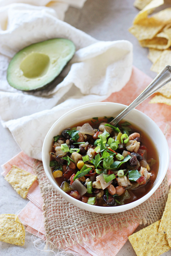 Recipe for easy slow cooker vegetarian tortilla soup! Filled with veggies, beans and plenty of spices! Serve with lots of fun toppings!