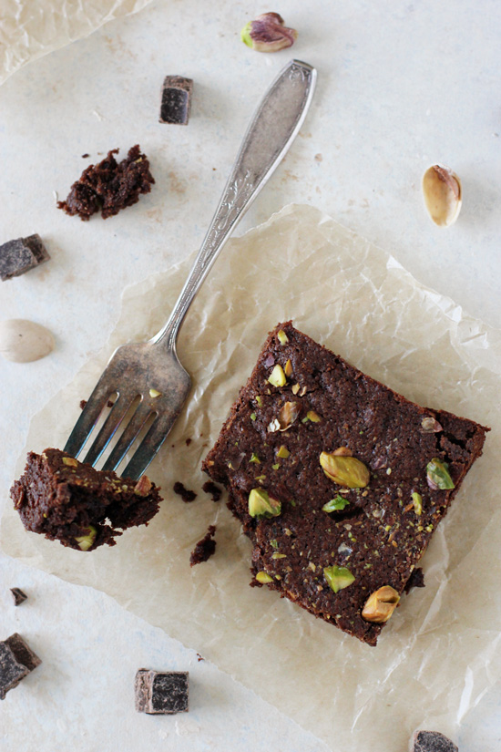 A one-bowl recipe for fudgy dark chocolate pistachio whole wheat brownies! Made with coconut oil and coconut sugar!