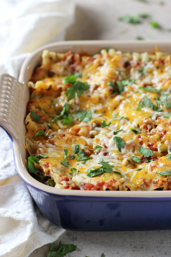 Recipe for easy sweet potato, black bean and kale lasagna. A mexican-spin on lasagna with sweet potato puree, plenty of spices and cheese!