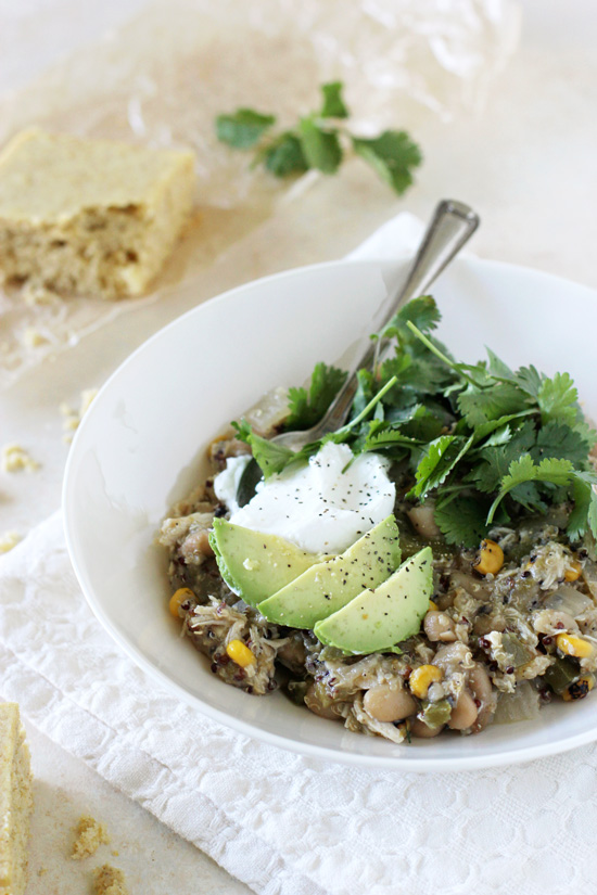 A healthy and protein packed slow cooker green chicken chili recipe! Filled with quinoa, white beans, peppers and salsa verde! So easy to make!