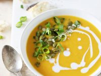 A simple, creamy and flavorful recipe for butternut squash soup! With thai-inspired flavors like ginger, coconut milk and roasted garlic!
