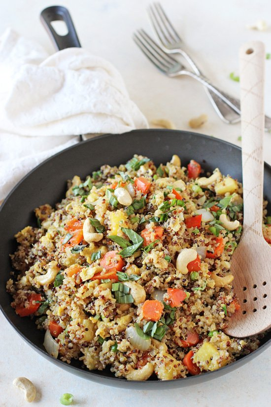 Healthy and easy pineapple cashew quinoa fried rice! Sweet, savory and packed with protein from the quinoa! On the table in about 30 minutes!