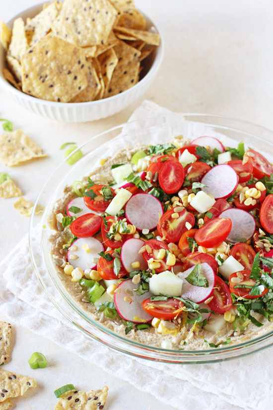 Healthy and easy garden veggie hummus dip! Colorful, super fresh and filled with a variety of summer veggies and herbs! A hit for any party!
