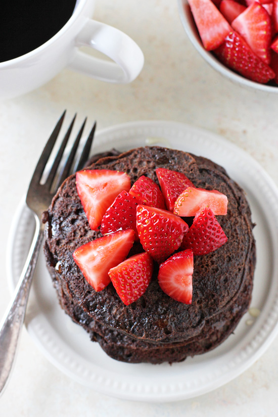 Light, fluffy and nutritious chocolate buckwheat pancakes! Top with fresh strawberries for a perfect pairing! Dairy free & gluten free!