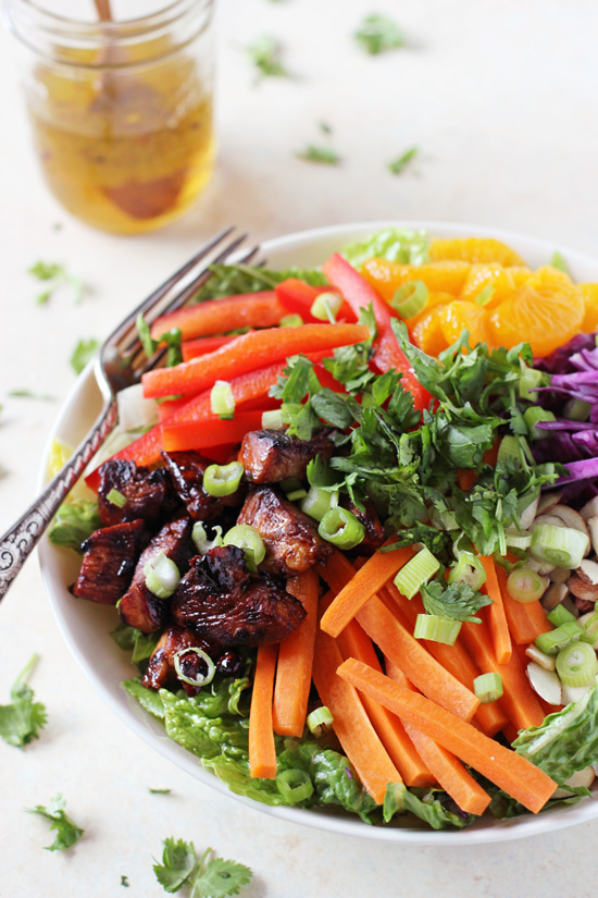 Colorful and healthy chopped asian chicken salad! With sticky, juicy chicken, crunchy veggies, mandarin oranges and a sweet & sour dressing!