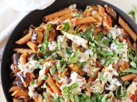 One-pot eggplant parmesan pasta skillet! All the flavors of the classic dish in a simple, everyday recipe! Packed with eggplant, whole wheat pasta and fresh basil!