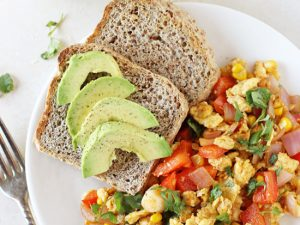 This 20-minute, healthy southwest egg scramble is a simple breakfast or dinner! Filled with bell pepper, fresh corn and plenty of spices!