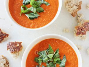 A creamy, healthy and homemade roasted cherry tomato soup! Serve topped with fresh basil and plenty of crusty bread!