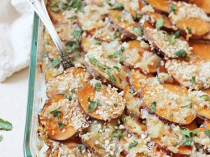 A healthier sweet potato gratin! Made with almond milk, shallots, cilantro and parmesan cheese! Comfy, cozy and no heavy cream in sight!
