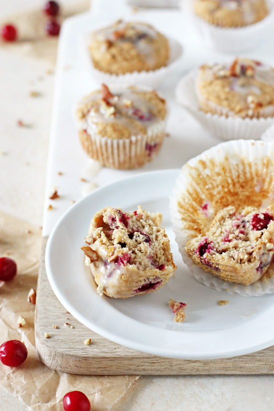 Soft and fluffy cranberry orange eggnog muffins! With whole wheat flour and sweetened with honey and maple syrup! Perfect for the season!