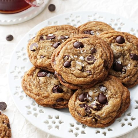 Chewy on the inside and crispy around the edges, these easy coconut oil espresso chocolate chip cookies are impossible to resist! And no mixer required! Filled with dark chocolate chips, melted coconut oil and a touch of espresso powder! Excellent for the holidays or any day of the week!