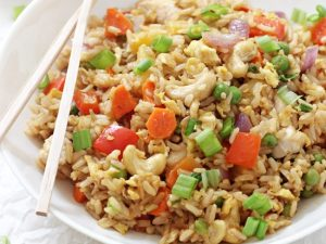 Make thai-style pineapple chicken fried rice at home! Simple, easy to make and much healthier than take-out! Packed with fresh veggies, brown rice, scrambled eggs and cashews!