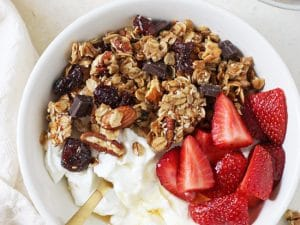 This berry chocolate coconut granola is simple to make and healthier than store-bought! Packed with nuts, fruit and dark chocolate!