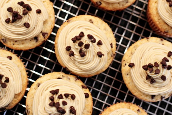 Several Chocolate Chip Cupcakes on a wire cooling rack.