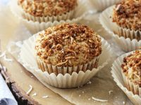 Light, fluffy & simple coconut muffins with streusel topping! Packed with coconut flavor from coconut milk, coconut flakes and extract! With an irresistible sweet topping!