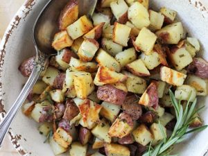 Crispy, creamy roasted red potatoes! This simple side is a perfect addition to any meal! With garlic, rosemary and thyme!