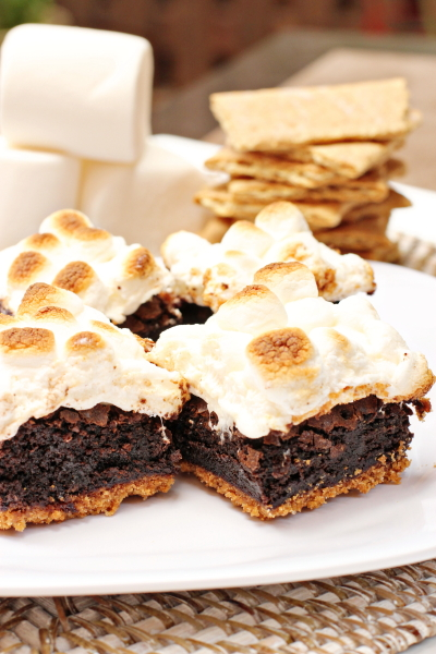 Several Brownie S'mores on a white plate.