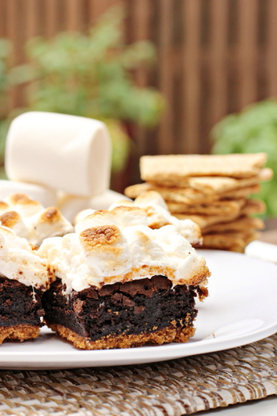 Two S'mores Brownies on a white plate.