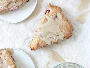 Soft and fluffy strawberries and cream scones! Filled with fresh strawberries and topped with a vanilla glaze, they are heavenly in every way!