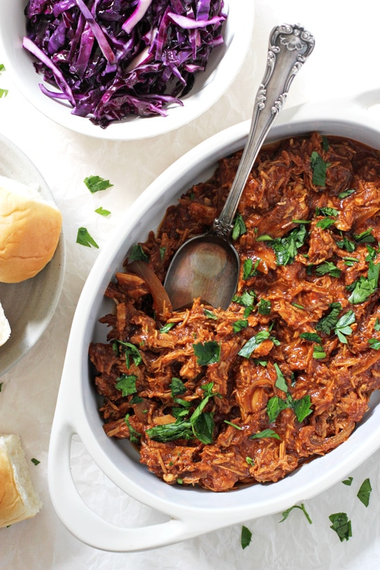 Easy crockpot pulled BBQ chicken! Let your slow cooker do all the work for this crowd pleasing favorite! Packed with flavor, perfect for a crowd and so many ways to put it to use!