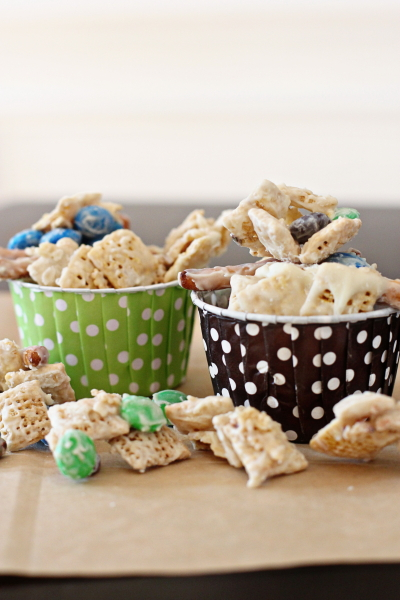 Two baking cups filled with Gluten Free White Chocolate Snack Mix.