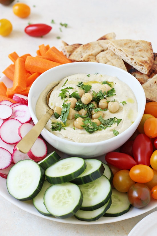 This creamy restaurant-style hummus is perfect for snacking or entertaining! Easy to make and perfectly smooth and fluffy!