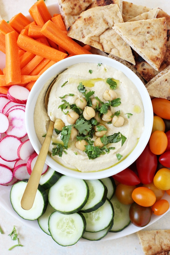 This creamy, dreamy restaurant-style hummus is a perfect snack! So smooth and fluffy, without having to peel the chickpeas!