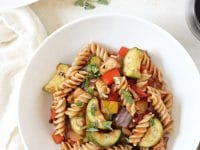 Light yet filling, this pasta with ratatouille-style vegetables is perfect for summer to fall! Filled with colorful veggies, whole wheat pasta and fresh herbs!