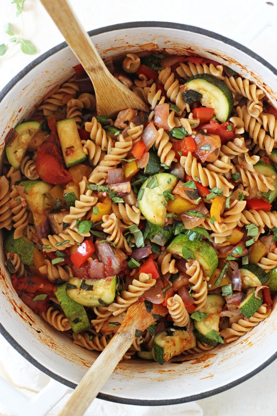 Flavorful and fun pasta with ratatouille-style vegetables! Packed with colorful veggies, whole wheat pasta, fresh herbs and a tomato-y sauce!