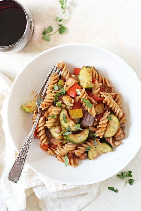 This pasta with ratatouille-style vegetables is perfect for a late summer dinner! Filled with zucchini, eggplant, bell pepper and whole wheat pasta!