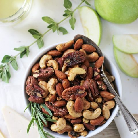 These super easy spiced rosemary and thyme nuts are a fantastic appetizer, snack or gift! Savory, a touch sweet and a tad bit spicy!