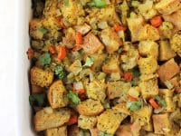 This classic thanksgiving stuffing is a staple at our holiday table! Filled with carrots, celery, rosemary and thyme, it bakes up crisp on top and perfectly soft underneath!