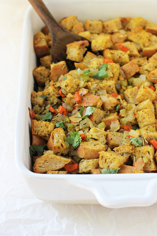 Cozy and classic thanksgiving stuffing! A total staple for the holidays! Filled with carrots, celery and herbs, it bakes up crisp on top yet soft underneath!