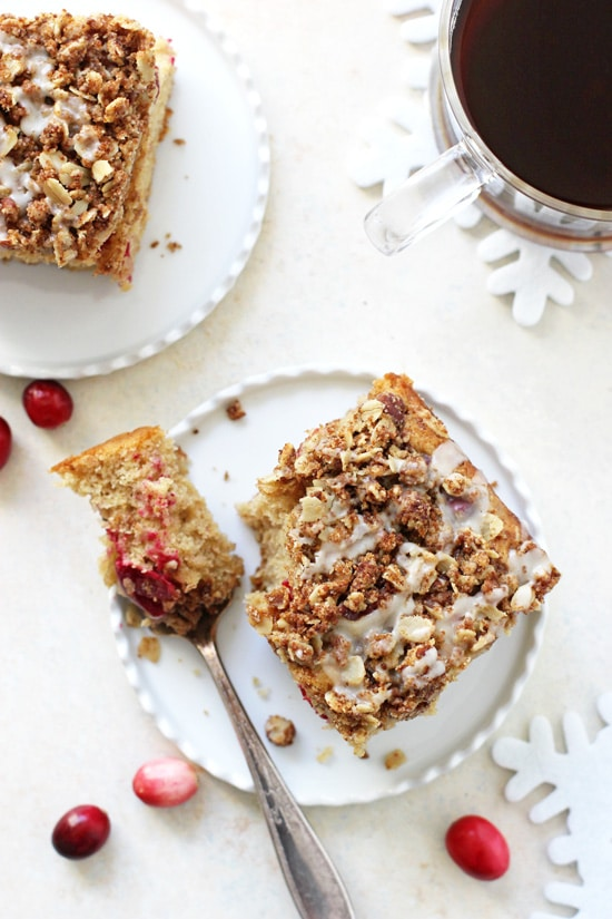 This cranberry eggnog coffee cake is the perfect holiday treat! With a light and tender base filled with fresh cranberries and eggnog, and finished with an oatmeal streusel!