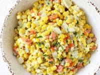 This creamy holiday corn is perfect for the season! Simple to make and filled with celery, carrots and herbs! A great make ahead dish!