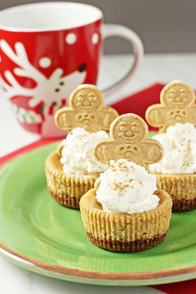 Three Mini Gingerbread Cheesecakes on a plate with a Christmas mug.